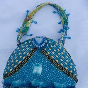 NWOT Blue beaded bag.